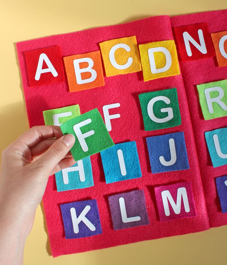 Make a darling felt book alphabet matching game for preschool aged kids using craft felt and heat transfer vinyl from Expressions Vinyl.