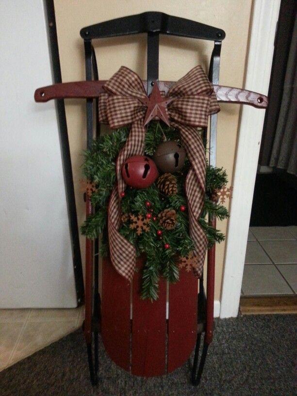 3 feet high Flexible flyer sled with cranberry bow, jingle bells and greenery