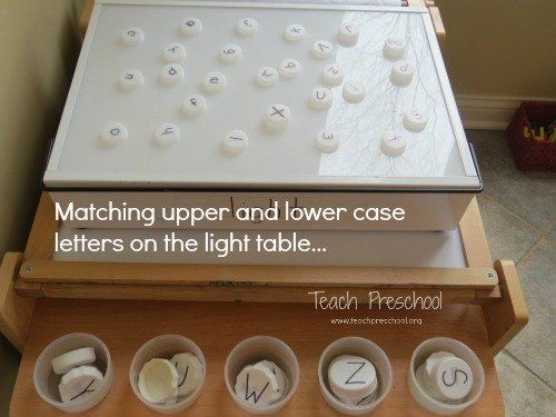 Matching upper and lower case letters on the light table by Teach Preschool