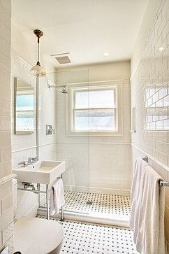 Glass shower allows for more natural light and makes space feel larger