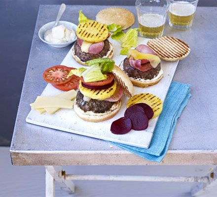 Aussie burgers with the lot  ...  Stack your grilled beefburgers with cheese, bacon, pineapple, beetroot, tomato and lettuce - the Australian way.
