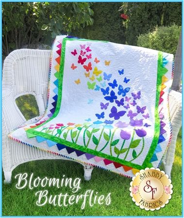 """Brighten your little girls room with this darling Blooming Butterflies Quilt! This 40½"""" x 51½"""" quilt features a beautiful array of butterflies floating on a gentle breeze over a bed of blooming tulips, finished with bright prairie points for the inner border. Pattern includes instructions and diagram to complete the quilt. Don't want to cut out all 91 shapes yourself? View the Blooming Butterflies Quilt Kit where each laser piece has been pre-cut and pre-fu..."""