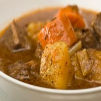 Mutton Stew Recipe - Mutton deep fried in spices and flour, served with beans, potatoes, carrots.