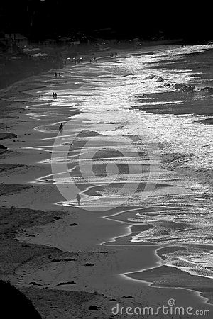 Black and white picture of Crystal cove Beach with waves and people in California