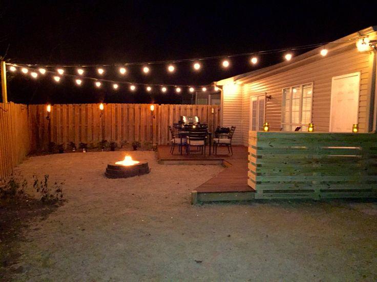 lighting tiki torches. industrial string lights tiki torches custom concrete tile top bar lighting