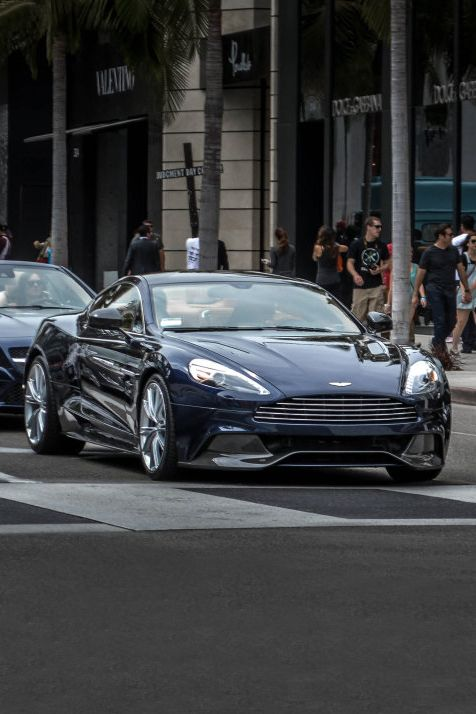 Aston Martin Vanquish. My neighbor on Deal Court, Mission Beach had one. I could hear him coming from 3 or 4 blocks away. Awsome!!