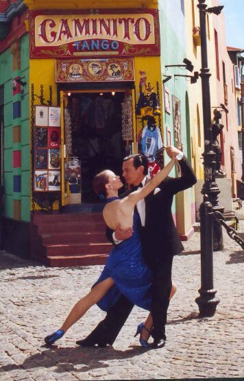 I want to visit 'Caminito' in Buenos Aires, Argentina, because I need to dance tango once in a lifetime :)