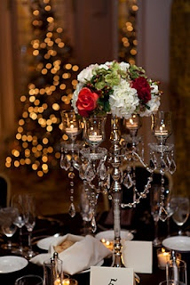 Beautiful silver crystal candelabras combined with flowers make a glamorous centerpiece