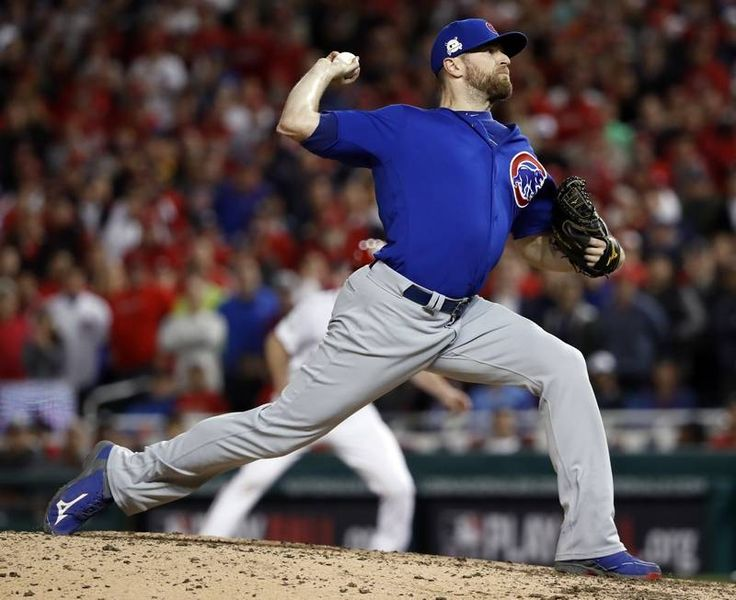 Chicago Cubs relief pitcher Wade Davis throws during the eighth inning in Game 5 of baseball's National League Division Series against the Washington Nationals, at Nationals Park, early Friday, Oct. 13, 2017, in Washington.