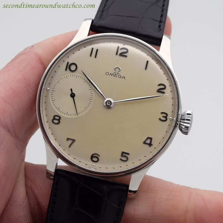 """A 1946 Vintage Omega Pocket Watch Conversion to a Wristwatch. This timepiece features a 44mm, stainless steel watch case, a silver dial with applied, Arabic numerals and dot markers, a """"see-through"""" exhibition-style case back and a 17-jewel, manual caliber 37.51 47P movement."""