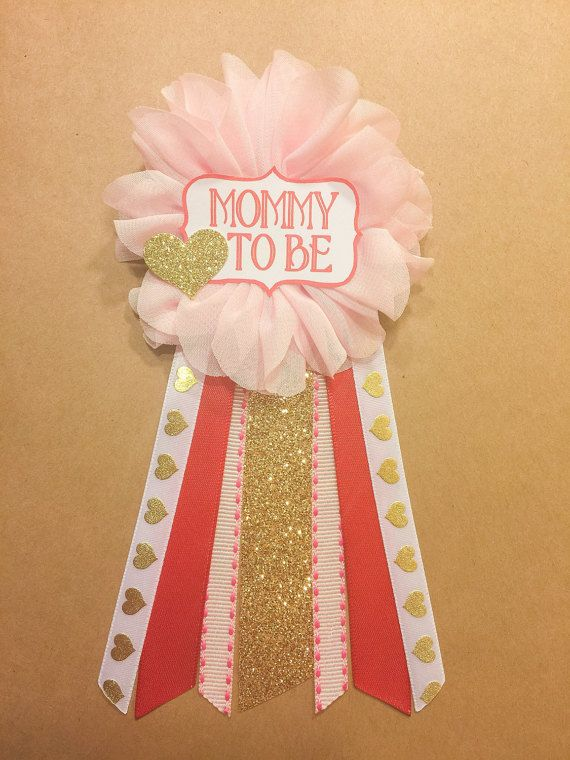 THIS PIN MEASURES APPROX 6.25 INCHES FROM TOP OF FLOWER TO BOTTOM OF RIBBONS. If you would like something longer, bigger, please message me. This pin is perfect for any baby shower addition! Can be pinned to any piece of clothing!  Pink flower corsage pin with ribbons from middle: gold glitter, thin pink, red satin, white with gold foil hearts. Choose one: please include in order notes. Mommy Mommy to be Grandma Auntie Its a girl Its a boy *custom name*  Red tag with a gold glitter heart…