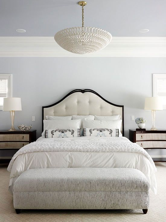 In the market for a stylish new neutral? Give gray a try. In this bedroom, cool gray walls and a gray-painted ceiling create a soothing and tranquil environment. Accessories in shades of creamy white and dark wood tones on the furniture lend contrast. What we love: The symmetrical arrangement of furnishings looks classic and elegant. The statement-making headboard draws the eye forward.