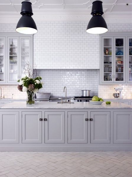 Grey cabinets, carrera marble, and white subway tile.