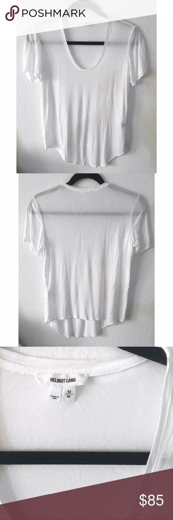 Helmut Lang White Tee This Helmut Lang shirt is a wardrobe staple. It is in perfect condition - only worn once or twice. As the photos show, it is on the sheerer side - perfect for showing off a pretty bra or bralette. I am open to reasonable offers! This top is a size medium, but I would say it fits more like a small. Would also fit size medium if you're looking for a tighter fit! Helmut Lang Tops Tees - Short Sleeve