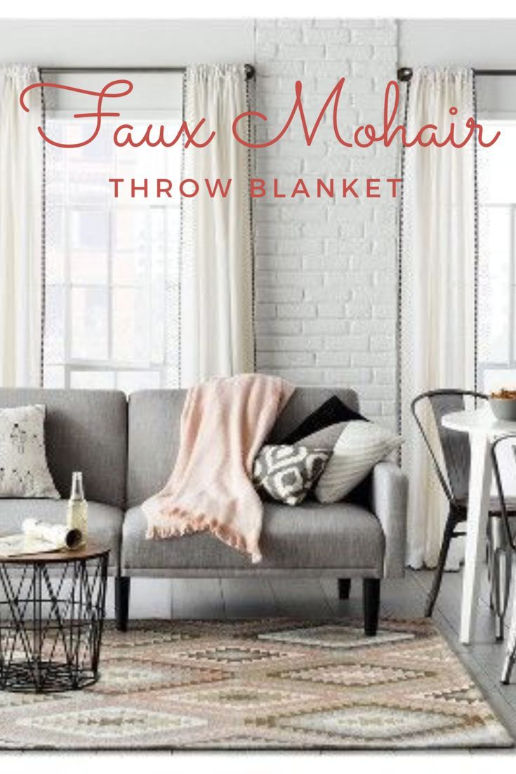 I like how the blanket adds a nice pop of color to a neutral living room. Threshold Faux Mohair throw blanket. #livingroomdecor#fauxmohair#fauxmohairthrowblaket#afflink#throwblanket#threshold#homedecor