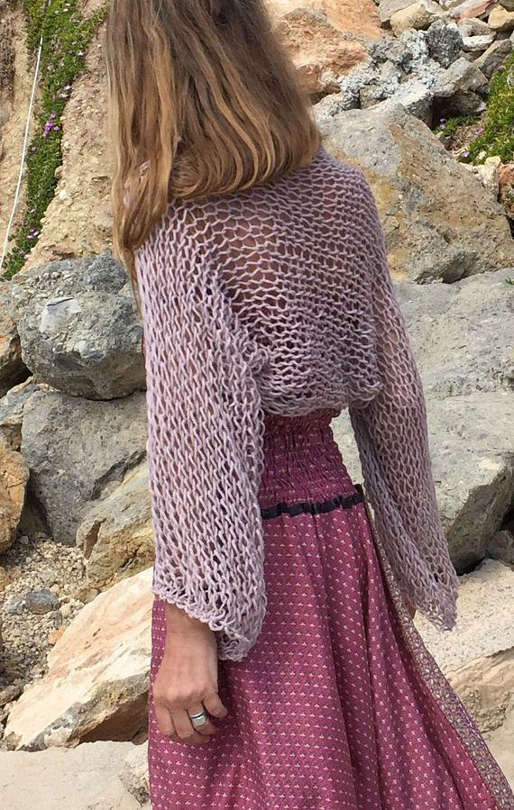 this loose knit, open weave, wide sleeve shrug, is a perfect cover up for the Spring / Summer season, the yarn is a pinky lilac, made from a mix of 30% Wool 50% Acrylic 20% Alpaca  other shade are available, ie: brown, black gray, pale pink, orange, ivory, Aqua, cream please convo me if youd like to see the shade card. The shrug is made to order with a lead time of 1 week.