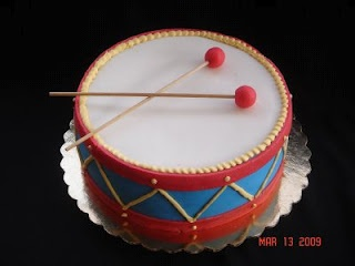 Drum Cake.  This was the picture I sent to the baker for Del's smash cake.  It came out great!  The colors were perfect for photos.
