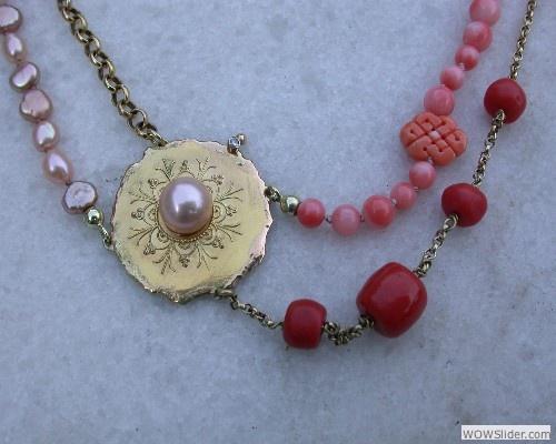 atelier 12hoven    fantasie collier samen gesteld van oude sieraden . Met bloedkoraal en zoetwater parels