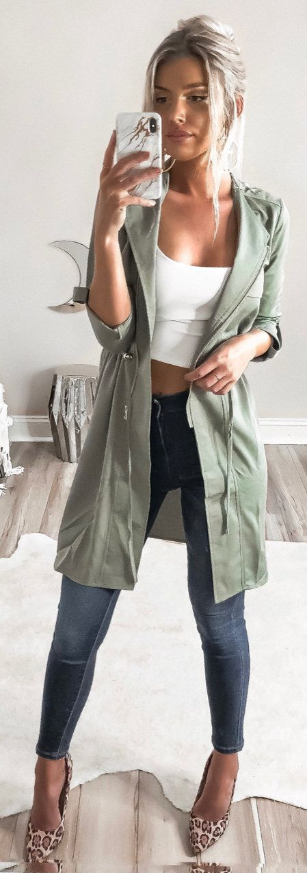 #winter #outfits gray overcoat, white crop-top, and blue jeans outfit