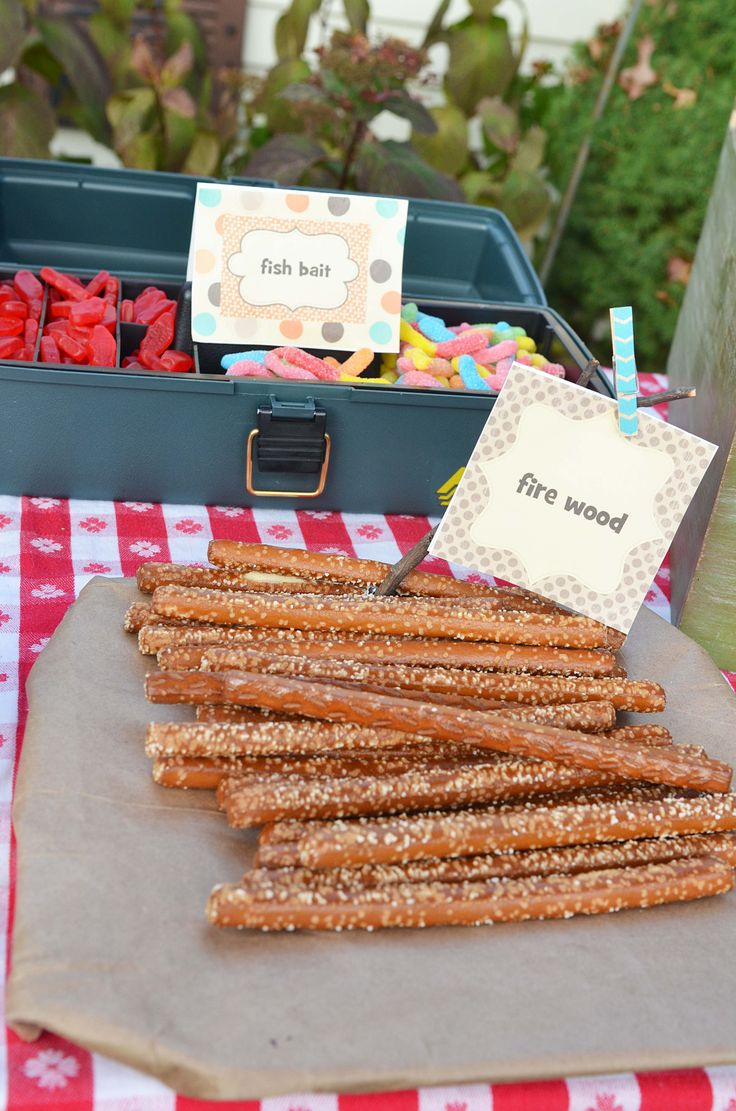 """Camping Birthday Party Ideas! Andrew's 8th Birthday Party!""""Fish Bait"""" in a tackle box and """"fire wood."""""""