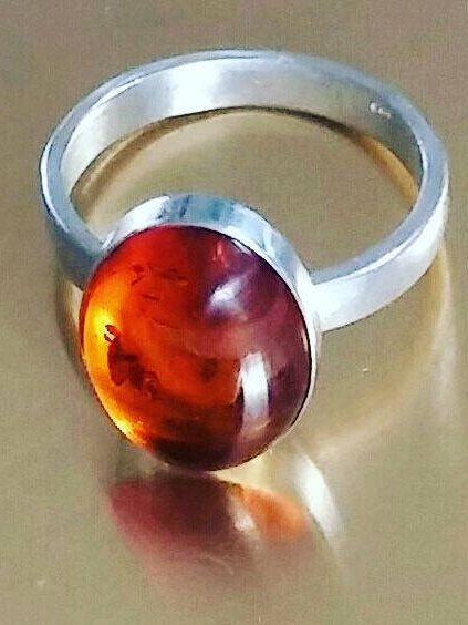 Women's oval shaped amber stone sterling silver ring