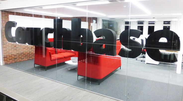 3D large floating letters in office window. These foam based letters were installed into a Manchester office to transform the space into something special. Design, manufacture and installation by Space3.co.uk