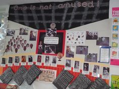 Victorian display for KS2, teachers face and kids faces included in Victorian style class with 'slates' of their work. 'One is not amused' Queen Victoria's catchphrase!