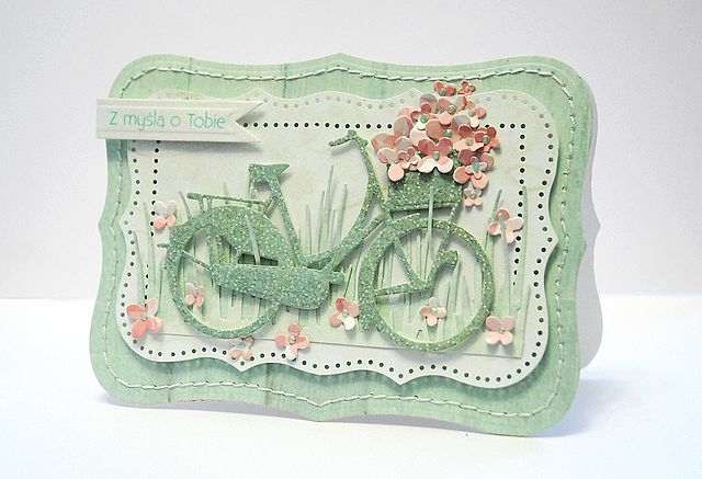 Cut bicycle with Cricut out of pastel paper, add flowers in basket