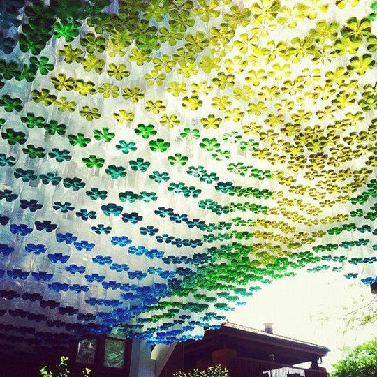 Parking canopy made of colored water in hanging plastic soda bottles... what an amazing idea!
