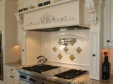 mantel over cooktop with pullout spice racks