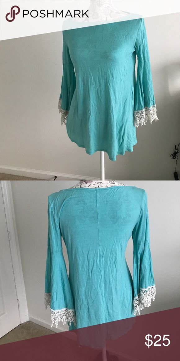 Mint Green Shirt with Lace Sleeve Trim In great condition no loose threads. Loose fitting and comfortable!!!! Will take reasonable offers!!!! Shirt Length is 23 1/2 inches and Sleeve length is 21 inches The Hanger Tops Blouses