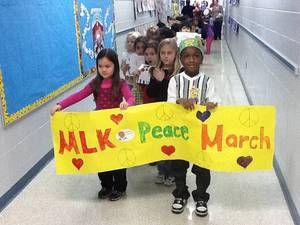 The Kindergarten classes celebrated Martin Luther Kings birthday with a culminating Peace March  throughout the school.  We discussed MLKs dream of equality for all people in a peaceful world. The students designed signs and held them up for everyone to see as they sang the song about Freedom. The students really enjoyed the Peace March and what a great way to use all our smarts to experience one of our famous Americans, Martin Luther King, Jr.
