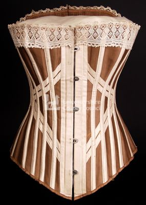 Lightweight busk front corset, around 1900 Woman's corset of around 1900, in brown sateen lined with cotton. Features a straight busk, double crossed straps, whale and split cane boning.