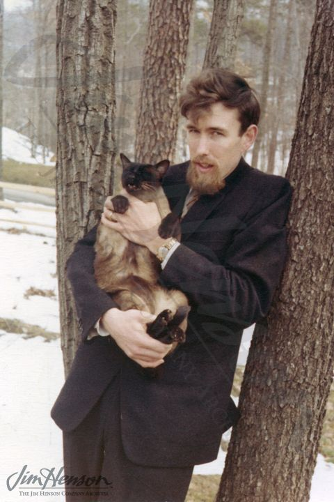 "From Jim Henson's personal journal ""The Red Book""   Jim and his Siamese cat named George Washington in Bethesda, c.1961. http://www.henson.com/jimsredbook/2012/06/07/671965-2/#"
