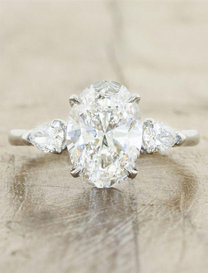 elegant oval cutting three-stone engagement ring
