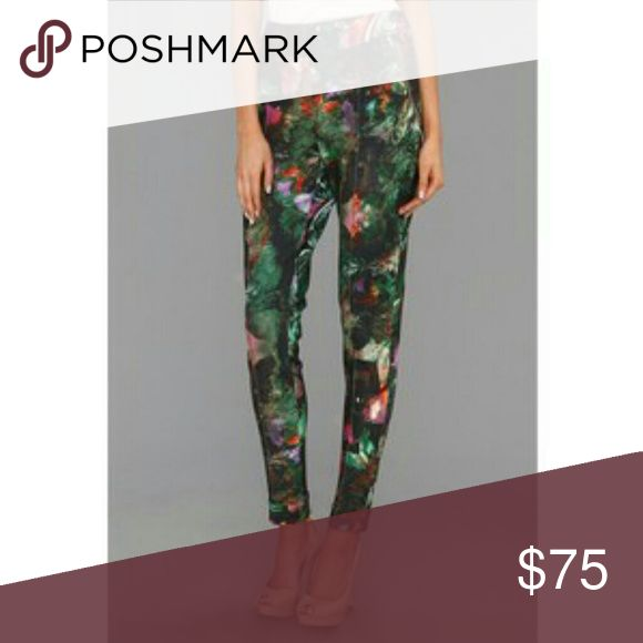Ted Baker Olivie High Waisted Legging US Size 4 Make a stylish statement in these superchic Ted Baker? pants. Classically tailored ankle pant features a high rise and a slightly tapered leg. Sleek stretch fabrication sports a feminine floral print throughout. Flat waistband with side-zip closure. Center pleat at front and back. Front-zip pockets. 96% polyester, 4% elastane. Hand wash cold, hang dry. Imported. Measurements: Waist Measurement: 30 in. Outseam: 40 in. Inseam: 32 in. Front Rise…