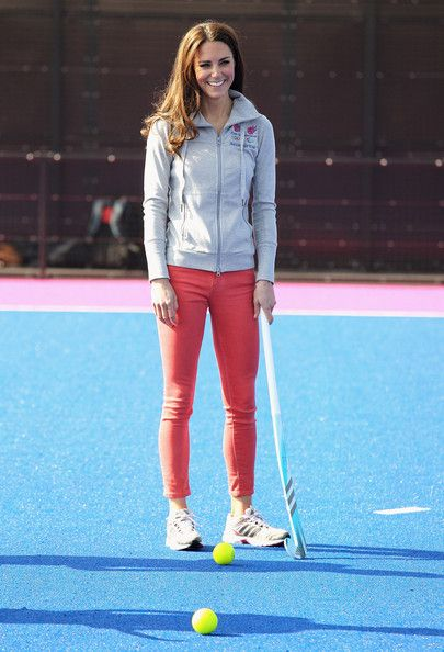 Catherine, Duchess of Cambridge in a coral jeans by J Brand paired with an official 2012 hoodie and trainers plays hockey with the GB hockey teams at the Riverside Arena in the Olympic Park on March 15, 2012 in London, England.