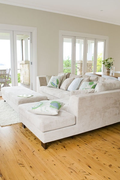 Wooden floor, bifold doors  with lots of light, and lovely. sofa....clean comfy bright feel!!