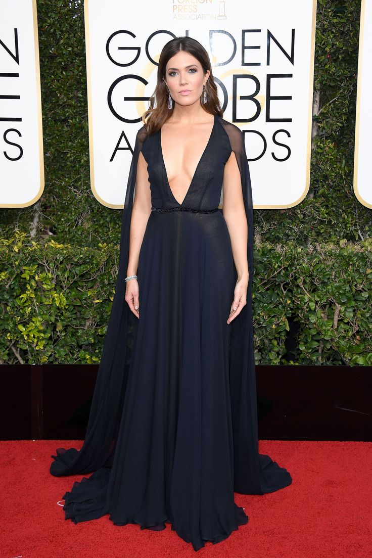 It'd seem that plunging necklines were the secret ingredient to slaying the red carpet tonight, and Mandy Moore got the memo. The This Is Us actress looks stunning in this navy Naeem Khan number. #refinery29 http://www.refinery29.com/2017/01/135216/golden-globes-2017-red-carpet-fashion#slide-2