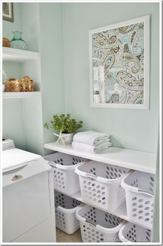 Simple framed fabric idea: get a pattern you like, cut into small squares for bathroom frames.  Laundry Room Makeover - Sorting Station