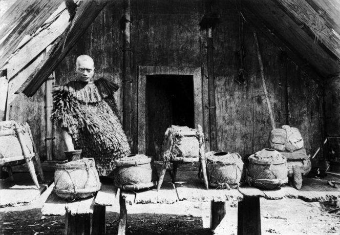 Koro Pai Kanohi at Mataatua Marae,  Ruatahuna, this time a few years later with pigeon preserved in pots.... 1910