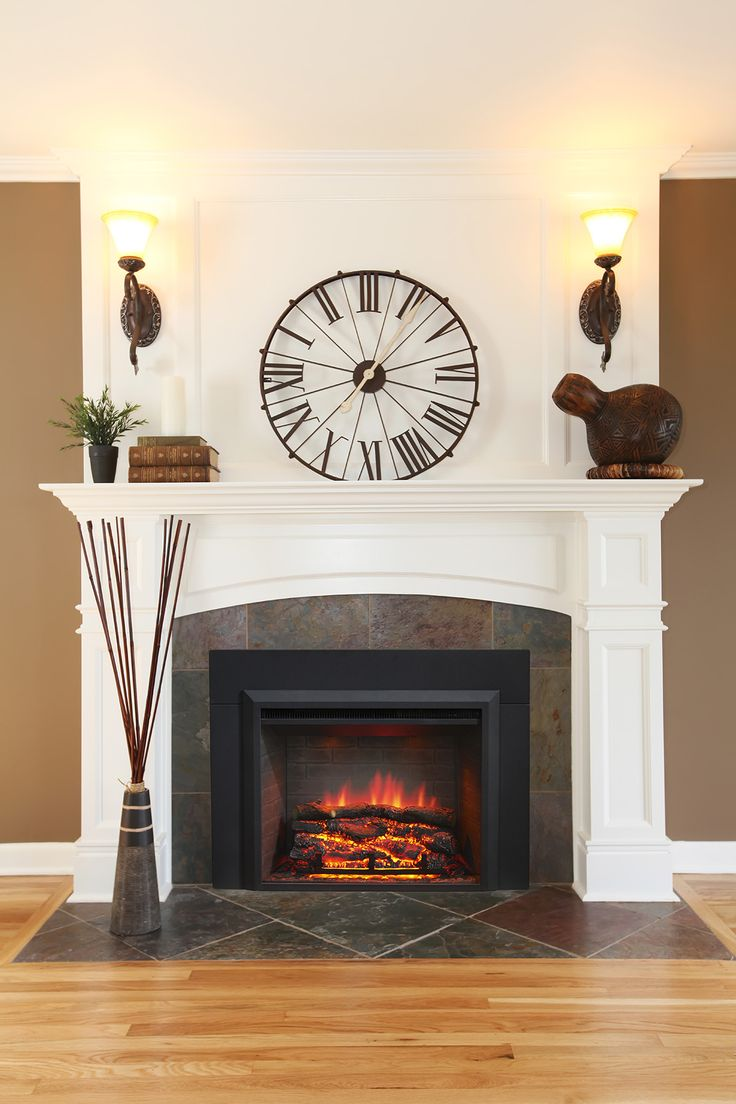 An electric fireplace insert! Convert your old wood burning fireplace into an easy to use, mess free electric fireplace! www.outdoorrooms.com  Original photo (c) Irina88W
