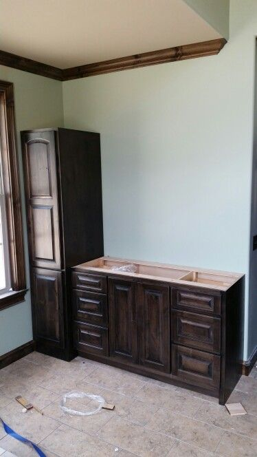 Custom Vanity Base And Linen Tower With Knotty Alder Wood Doors Finished With Sherwin Williams