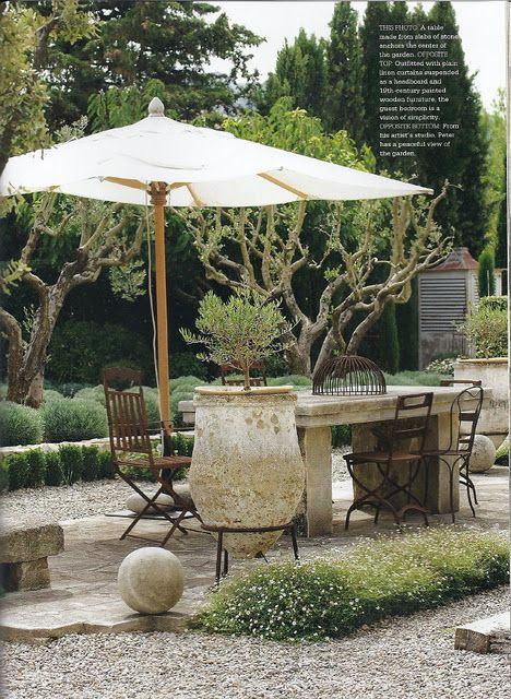 another monochrome patio: Gardens Stones, Mediterranean Gardens, Umbrellas, Gravel Patio, Stones Tables, Patio Stones, Outdoor Living Spaces, Outdoor Tables, Peas Gravel