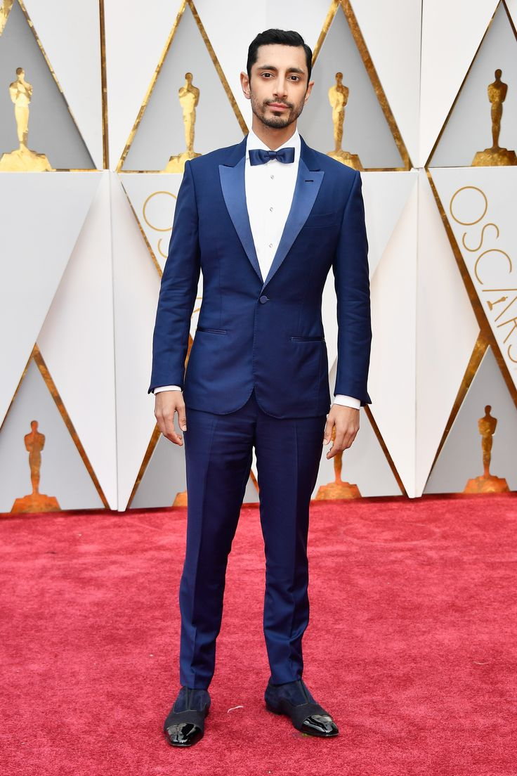Riz Ahmed in Ermenegildo Zegna Couture, Montblanc tuxedo shirt studs and cuff links, and Christian Louboutin