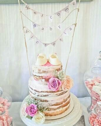 Such a beautiful spring floral naked cake for her baby shower celebration! Baby's breath and roses are the perfect touch.