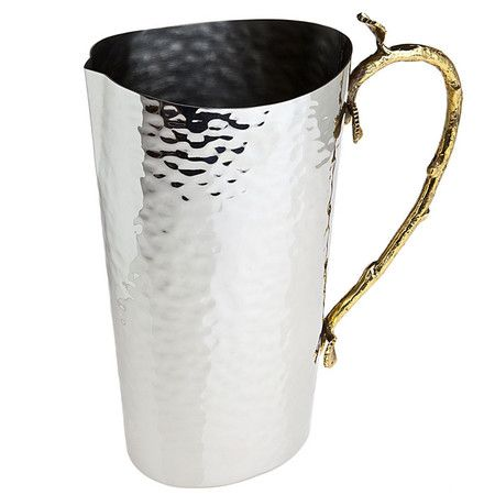 Textured stainless steel pitcher with a brass branch-inspired handle.Product:  Pitcher  Construction Material: Hi...