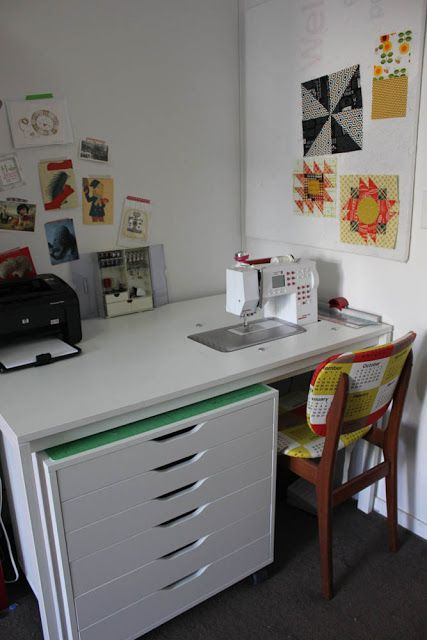 This is the perfect sewing table...with drawers that roll out for a cutting/pressing table...plus the roll out will hold the bulk of the quilts you are wrestling with !   Make Your Own Sewing Desk Tutorial | badskirt
