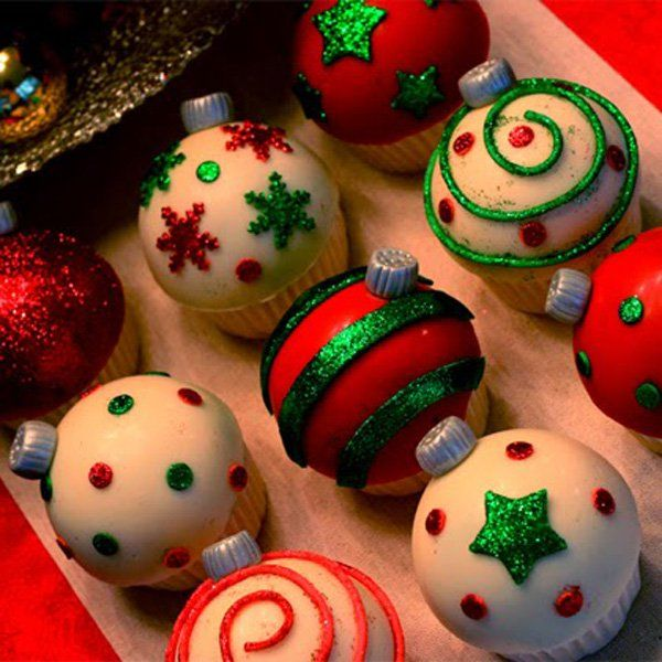 Christmas balls inspired mini cakes. The mini cakes are creatively designed to look like Christmas balls in various colors and patterns.
