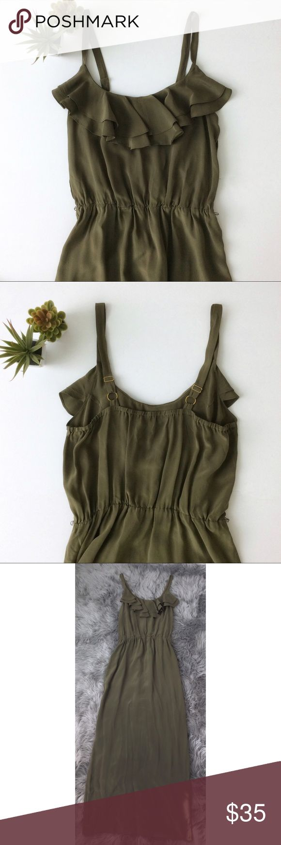 Calvin Klein Silk Maxi Dress 100% silk maxi dress by Calvin Klein in a beautiful olive green.  Elasticized waist.  Ruffle neckline.  Adjustable straps.  Very feminine and flowy. Calvin Klein Dresses Maxi